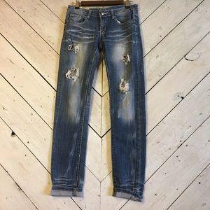 Distressed Machine jeans